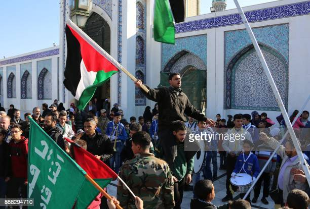 Syrian and other Shiite Muslims demonstrate after the Friday prayers outside the mausoleum of Sayyida Zeinab granddaughter of the Prophet Mohammed in...