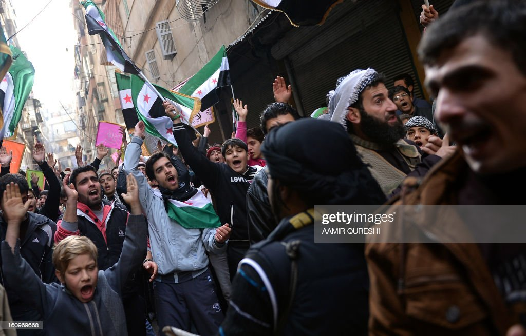 Syrian anti-regime protesters shout slogans during a demonstration after the weekly Friday prayers in the Bustan al-Qasr district of the northern city of Aleppo on February 8, 2013. Syrian forces shelled rebel belts, the Syrian Observatory for Human Rights said, as an army offensive raged into a third straight day.