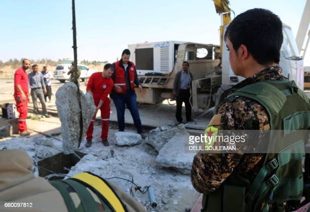 Syrian Arab Red Crescent members and Syrian Democratic Forces inspect on March 29 2017 the Tabqa dam which has been recently partially recaptured by...