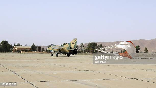 A Syrian army jet lands in Dmeir military airport 50 km northeast of Damascus on April 8 2016 / AFP / STRINGER