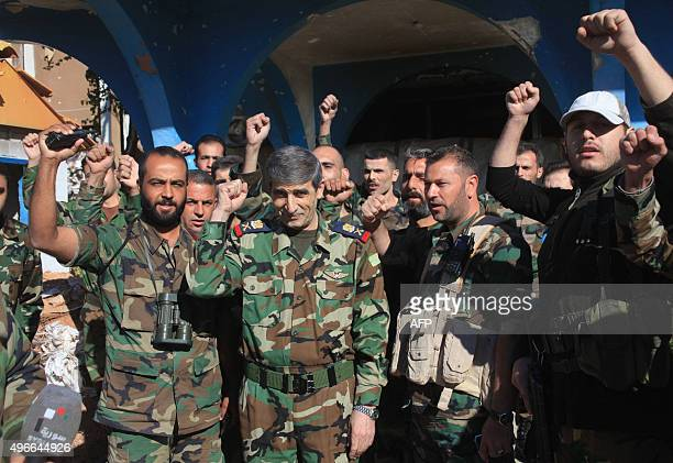 Syrian army Major General Mounzer Zamam celebrates among soldiers at the Kweyris military air base in the northern Syrian province of Aleppo on...