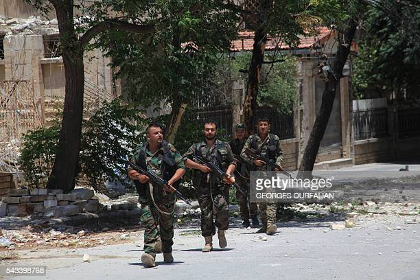 Syrian army soldiers patrol a street in governmentcontrolled Aleppo's alKhalidiya area where the army progressed towards the industrial zone of...