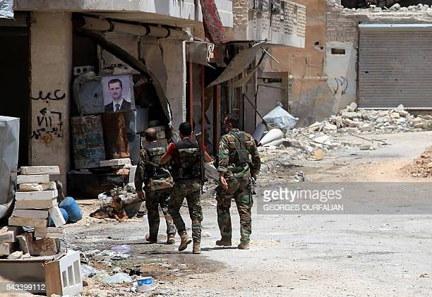 TOPSHOT Syrian army soldiers patrol in governmentcontrolled Aleppo's alKhalidiya area where the army progressed towards the industrial zone of...