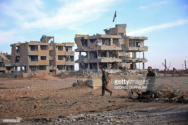 Syrian army soldiers patrol the countryside of Deir Hafer a former bastion of Islamic State group near the northern Syrian city of Aleppo on December...