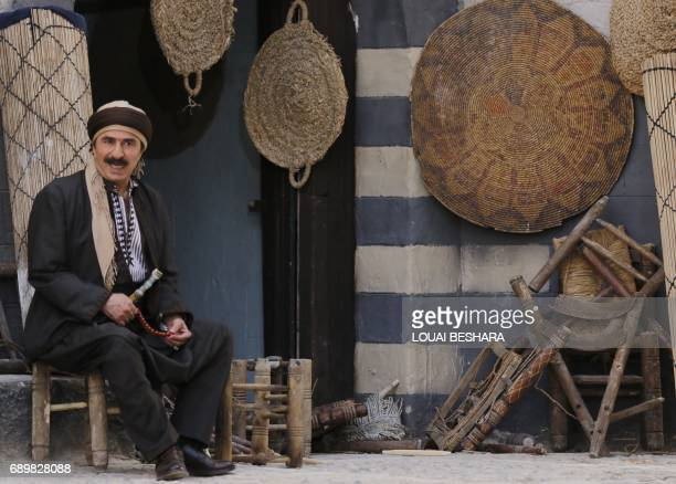 Syrian artist Rashid Assaf is seen on the filming set of television series 'Tawq alBanat' in the village of Yaafur some 20kilometres west of Damascus...