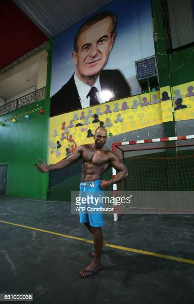 A Syrian bodybuilder poses as he participates in a national bodybuilding championship held for the first time at the AlJalaa stadium in alMazzah...