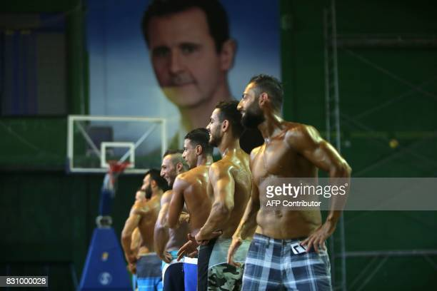 Syrian bodybuilders perform in front of a jury during a national bodybuilding championship held for the first time at the AlJalaa stadium in alMazzah...