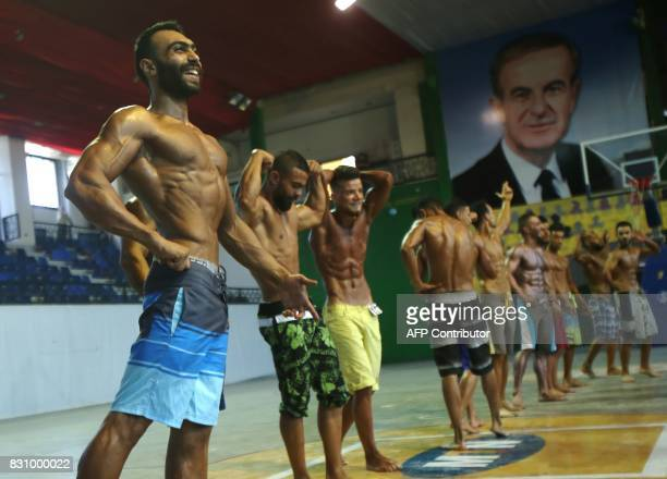 Syrian bodybuilders take part in a national bodybuilding championship held for the first time at the AlJalaa stadium in alMazzah district of the...