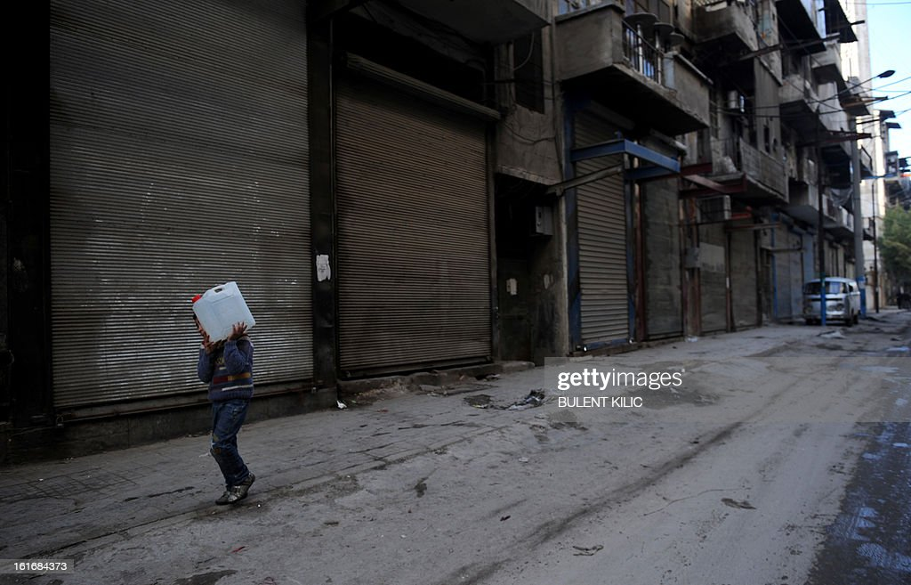 A Syrian boy carries water back to his family in the northern city of Aleppo on February 14, 2013. Syrian Foreign Minister Walid al-Muallem and opposition National Coalition chief Ahmed Moaz al-Khatib will make separate visits to Moscow for talks in the coming weeks, a top Russian diplomat said.