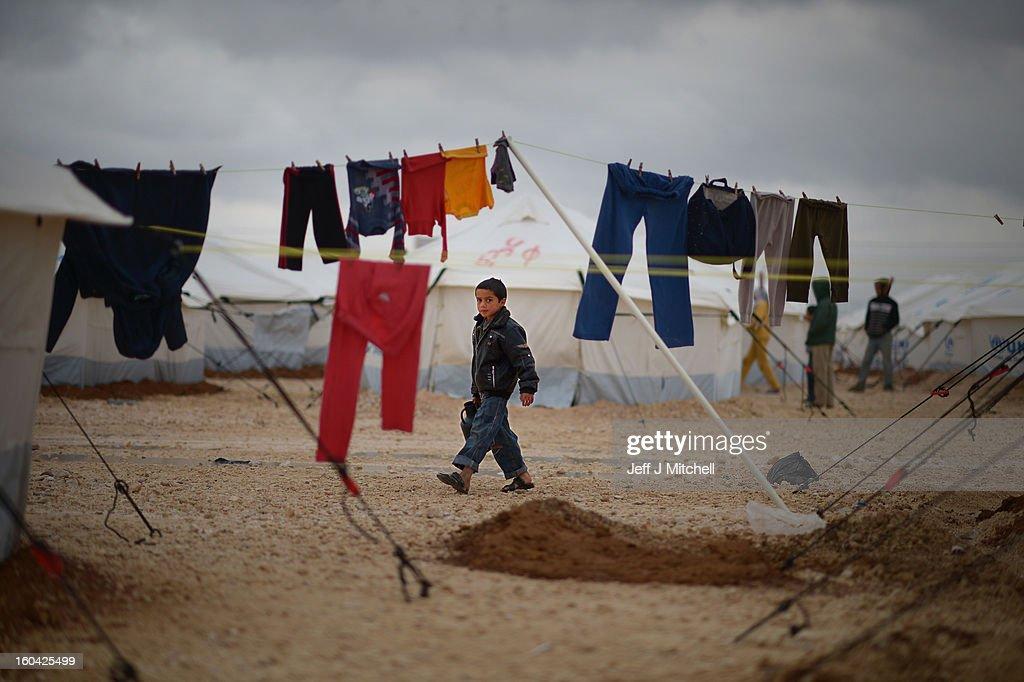 ZA'ATARI JORDAN JANUARY 31 A Syrian boy collects water in the Za'atari refugee camp on January 31 2013 in Za'atari Jordan Record numbers of refugees...