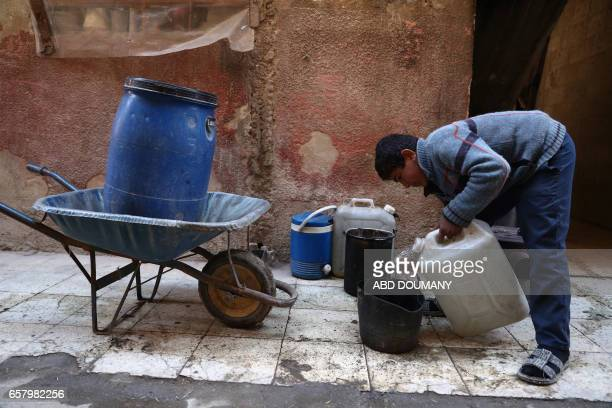 Syrian boy fills water from a jerrycan in the rebelcontrolled town of Kafr Batna in the eastern Ghouta region on the outskirts of the capital...