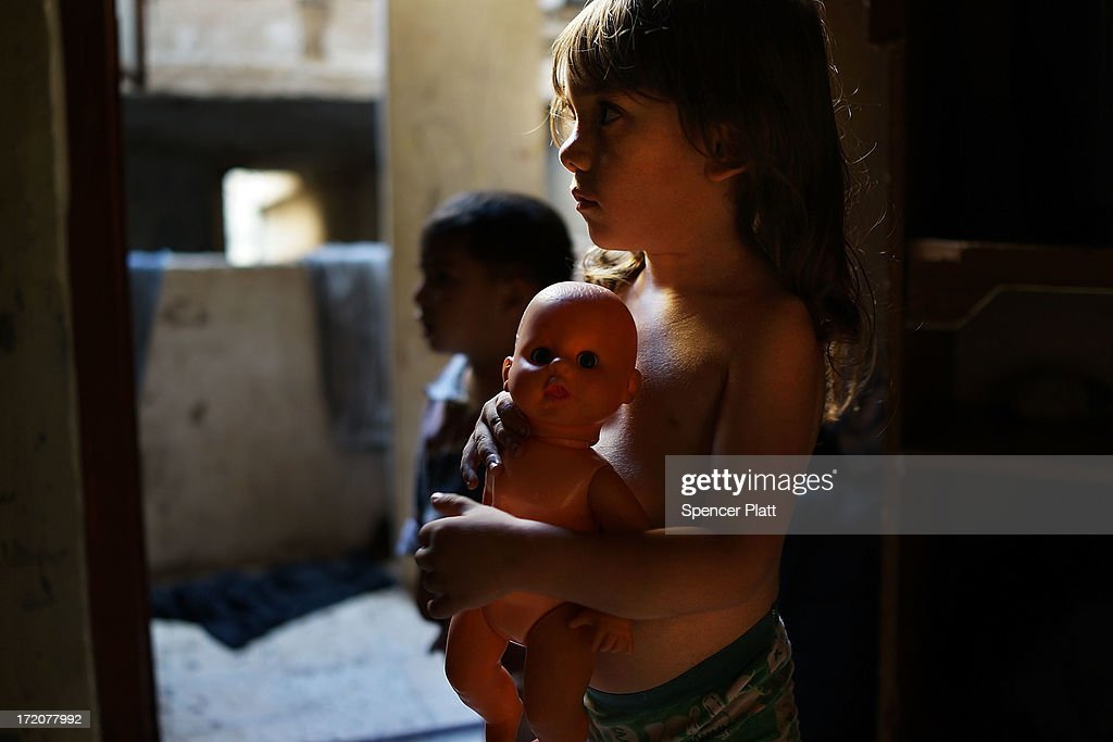 A Syrian boy named Abrahim from the the city of Idlib pauses in the home he shares with over 20 extended members of his family in a poor neighborhood with a high concentration of Syrian refugees on July 01, 2013 in Beirut, Lebanon. Currently the Lebanese government officially hosts 546,000 Syrians with an estimated additional 500,000 who have not registered with the United Nations. Lebanon, a country of only 4 million people, is now home to the largest number of Syrian refugees who have fled the conflict. The situation is beginning to put a huge social and political strains on Lebanon as there is currently no end in sight to the war in Syria.