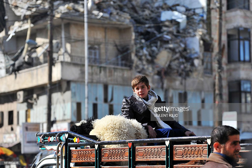 A Syrian boy sits atop a truck in the northern city of Aleppo on February 14, 2013. Syrian Foreign Minister Walid al-Muallem and opposition National Coalition chief Ahmed Moaz al-Khatib will make separate visits to Moscow for talks in the coming weeks, a top Russian diplomat said.