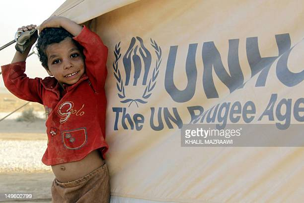 A Syrian boy stands at the Zaatari Camp Jordan's first official camp for Syrian refugees fleeing violence in their country near the Syrian border on...