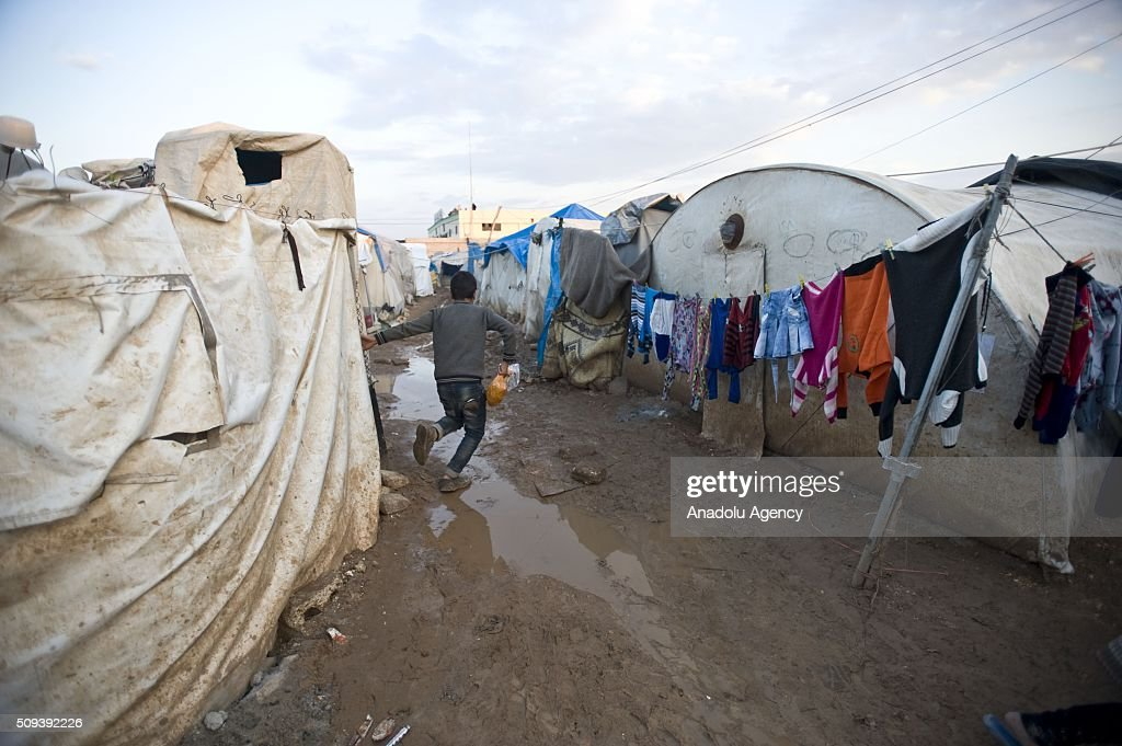 A Syrian boy, who fled bombing in Aleppo, is seen at a tent city close to the Bab al-Salam border crossing on Turkish-Syrian border near Azaz town of Aleppo, Syria on February 10, 2016. Russian airstrikes have recently forced some 40,000 people to flee their homes in Syrias northern city of Aleppo.