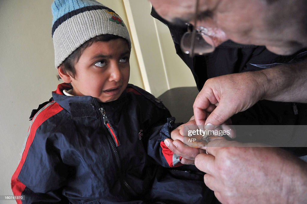Syrian boy who fled his war-torn country receives treatment in the Al-Bashaer clinic in the Abu Samra district of the northern Lebanese city of Tripoli on January 29, 2013. Dr. Ghazi Aswad receives dozens of women in a clinic set up by a charity of Tripoli in northern Lebanon and. Every day, he said, 'I see strong women who are their family at arm's length as they crumble before me.'