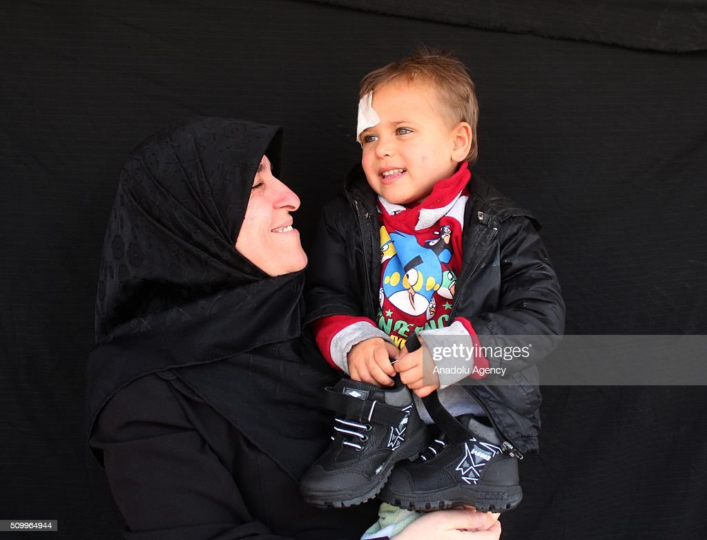 A Syrian boy, who has lost his father in the country's civil war, poses after the Sanliurfa Humanitarian Aid Platform provided clothes and toys to him in Sanliurfa, Turkey on February 13, 2016. The platform, which was established to carry out activities to help Syrian children, gave joy to children who had lost their parents in the Suleiman Shah camp. 115 children were brought to the Sanliurfa Humanitarian Aid Platform Charity Shop by minibuses to choose clothes for themselves.