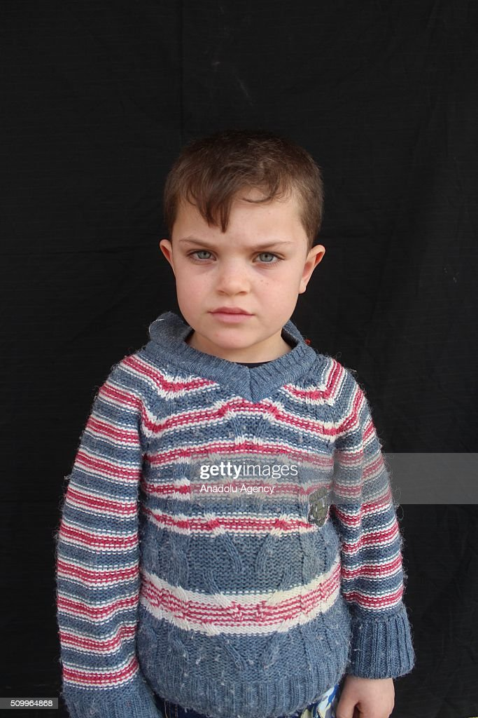 A Syrian boy, who has lost his parents in the country's civil war, poses after the Sanliurfa Humanitarian Aid Platform provided clothes and toys to him in Sanliurfa, Turkey on February 13, 2016. The platform, which was established to carry out activities to help Syrian children, gave joy to children who had lost their parents in the Suleiman Shah camp. 115 children were brought to the Sanliurfa Humanitarian Aid Platform Charity Shop by minibuses to choose clothes for themselves.