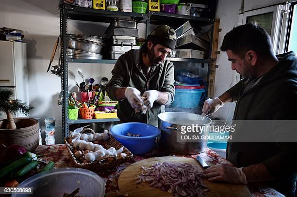 Syrian Chef Talal Rankoussi prepares a meal for the volunteers working in the Ritsona camp some 80 km north of Athens on December 21 2016 Before...