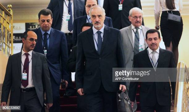 Syrian chief negotiator and Ambassador of the Permanent Representative Mission of Syria to the United Nations Bashar alJaafari walks with his...
