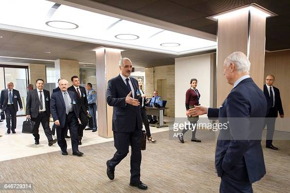 Syrian chief negotiator Bashar alJaafari Ambassador of the Permanent Representative Mission of Syria to UN New York shakes hand with UN Special Envoy...