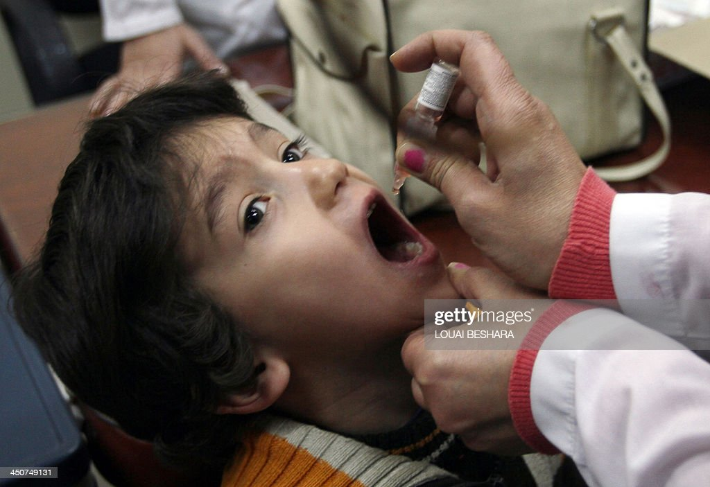 A Syrian child gets a polio vaccination at a clinic in Damascus on November 20 2013 The UN health agency launched a largescale campaign on October 24...