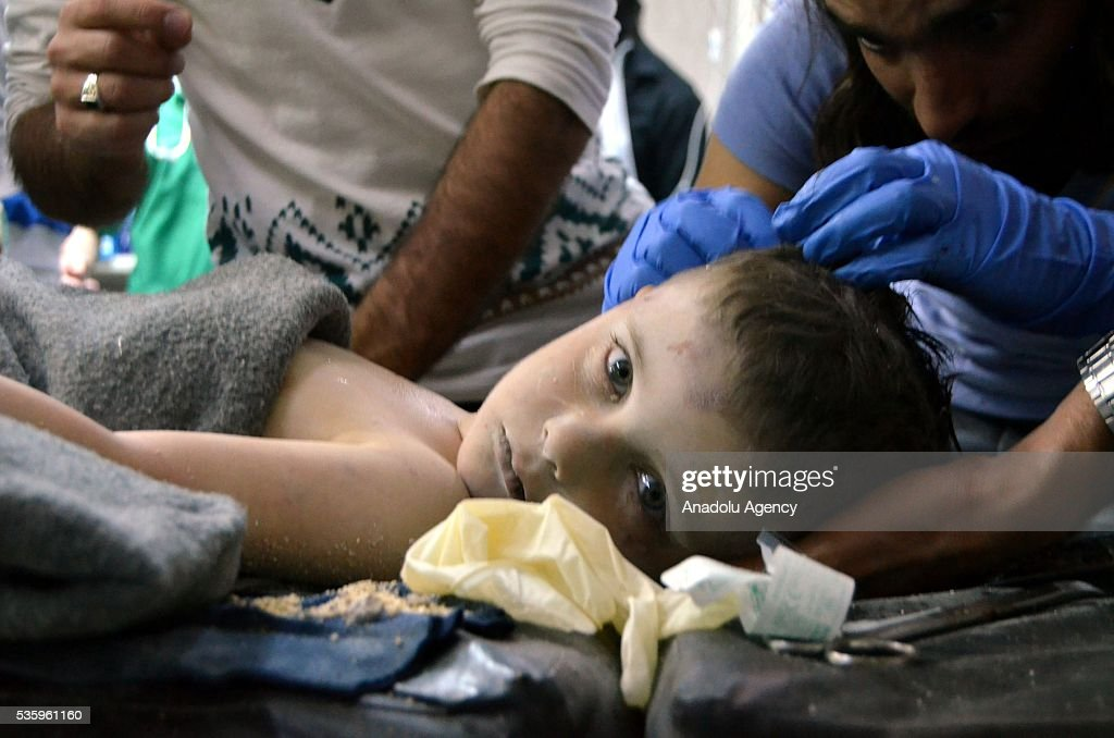 A Syrian child receives treatment at a hospital after the Russian airstrikes targeted the National Hospital (Ibn Sina) in Idlib, Syria on May 31, 2016.