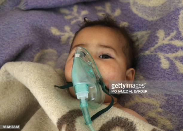 A Syrian child receives treatment at a small hospital in the town of Maaret alNoman following a suspected toxic gas attack in Khan Sheikhun a nearby...