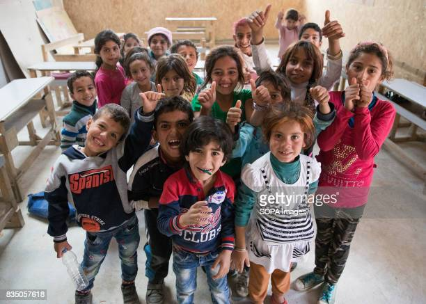 Syrian Child refugees are laughing and learning in class at a school recently built in a refugee camp at Al Marj The School at Al Marj has 4 class...