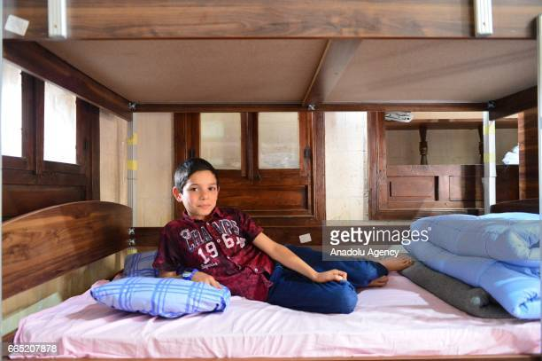 Syrian child sits on his bed at a boarding school which is a reconstructed mansion in Sanliurfa Turkey on April 6 2017 Fifty Syrian children who lost...