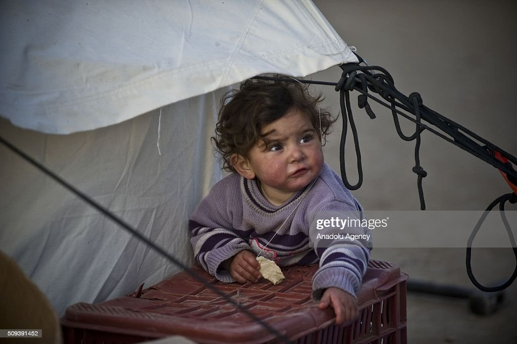 A Syrian child, who fled bombing in Aleppo, is seen at a tent city close to the Bab al-Salam border crossing on Turkish-Syrian border near Azaz town of Aleppo, Syria on February 10, 2016. Russian airstrikes have recently forced some 40,000 people to flee their homes in Syrias northern city of Aleppo.