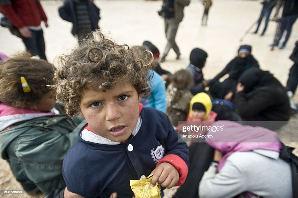 A Syrian child who fled bombing in Aleppo, is seen at the Oncupinar crossing, opposite the Turkish province of Kilis, near Azaz town of Aleppo, Syria on February 6, 2016. Thousands of Syrians have massed on the Syrian side of the border seeking refuge in Turkey.