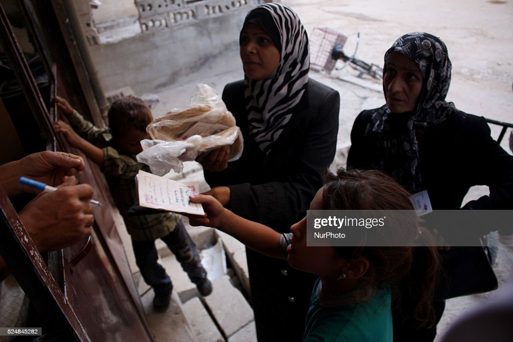 Syrian children and adult received bread The furnace was restarted a short time ago because of the high cost of fuel and the price of flour and in...