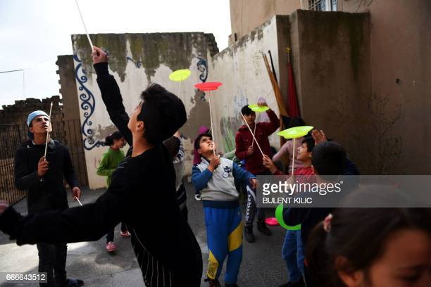 Syrian children and boys perfom during a circus class on the roof top of a building on March 19 in Mardin There is laughter excitement and a sense of...