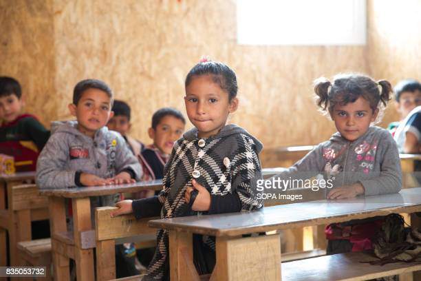Syrian children are pictured at a school in a refugee settlements in the Beqaa Valley close to the Syrian border