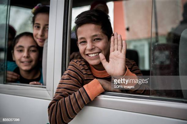 Syrian children are pictured every morning sitting on a bus while going at the school in one of the settlements in Al Marj