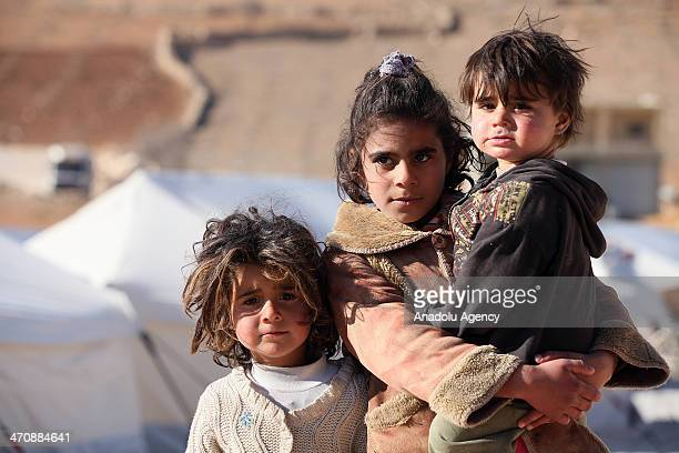 Syrian children are seen in a refugee camp in Lebanon's frontier town of Arsal on February 18 2014 in Beirut Lebanon Arsal refugee camp to host...