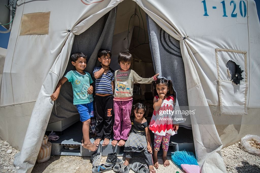 Syrian children are seen in Suruc district of Sanliurfa, Turkey on July 01, 2016, as the Syrian people who fled the clashes between Daesh and Kurdish armed groups about two years ego, make preparations for the Eid al-Fitr marks the end of the Muslim holy fasting month of Ramadan by preparing sweets despite the all harsh conditions at the camp away from their home.