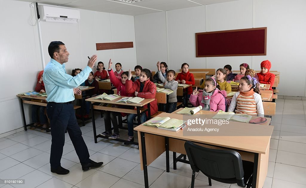 Syrian children attend class as they continue their education, in Malatya, Turkey on February 14, 2016. Around 300.000 Syrian children, including 80.000 in camps, continue their education at full equipped classrooms in Turkey.