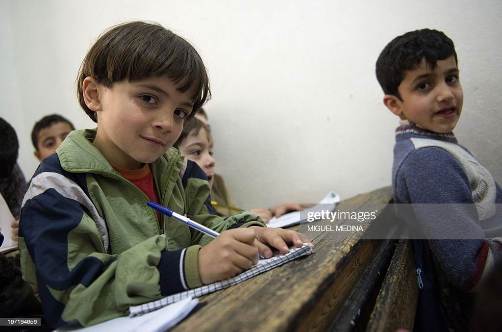 Syrian children attend class at a school in a rebel-controlled area of the northern city of Aleppo on April 22, 2013. The European Union offered fresh aid to Syria's opposition, easing an EU oil embargo in favour of the rebels fighting President Bashar al-Assad, but stopping short of supplying offensive weapons.