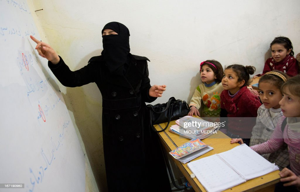 Syrian children attend class at a school in the northern city of Aleppo on April 22, 2013. The European Union offered fresh aid to Syria's opposition, easing an EU oil embargo in favour of the rebels fighting President Bashar al-Assad, but stopping short of supplying offensive weapons.