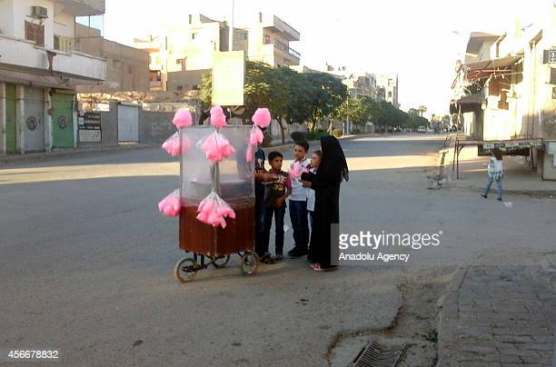 Syrian children buys cotton candy during the eid alAdha holiday in the ISIL controlled city Raqqa Syria on October 8 2014