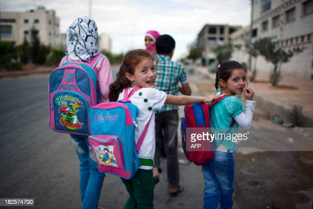 PAMPLIEGA Syrian children head to school in the Sheikh Najjar district in the northern Syrian city of Aleppo on September 23 2013 'The reopening of...