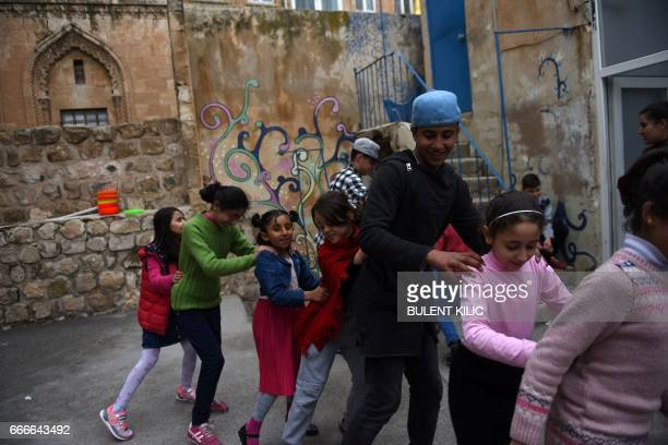Syrian children play as they attend a circus class on March 19 in Mardin There is laughter excitement and a sense of joyful chaos Some children are...