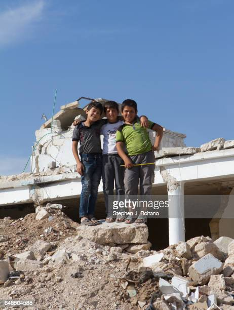 A'ZAZ ALEPPO SYRIA Syrian children play at bomb sites in A'zaz Syria