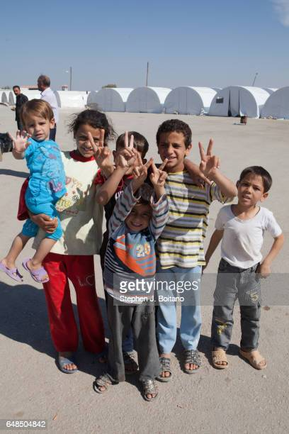 A'ZAZ ALEPPO SYRIA Syrian children play at the border with Turkey in A'zaz Syria