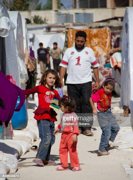 A'ZAZ ALEPPO SYRIA Syrian children play between tents at the border with Turkey in A'zaz Syria