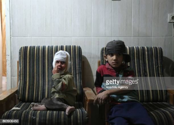 Syrian children receive medical treatment at the field hospital after Assad regime's airstrikes hit residential areas of the deconflict zone in Kafr...