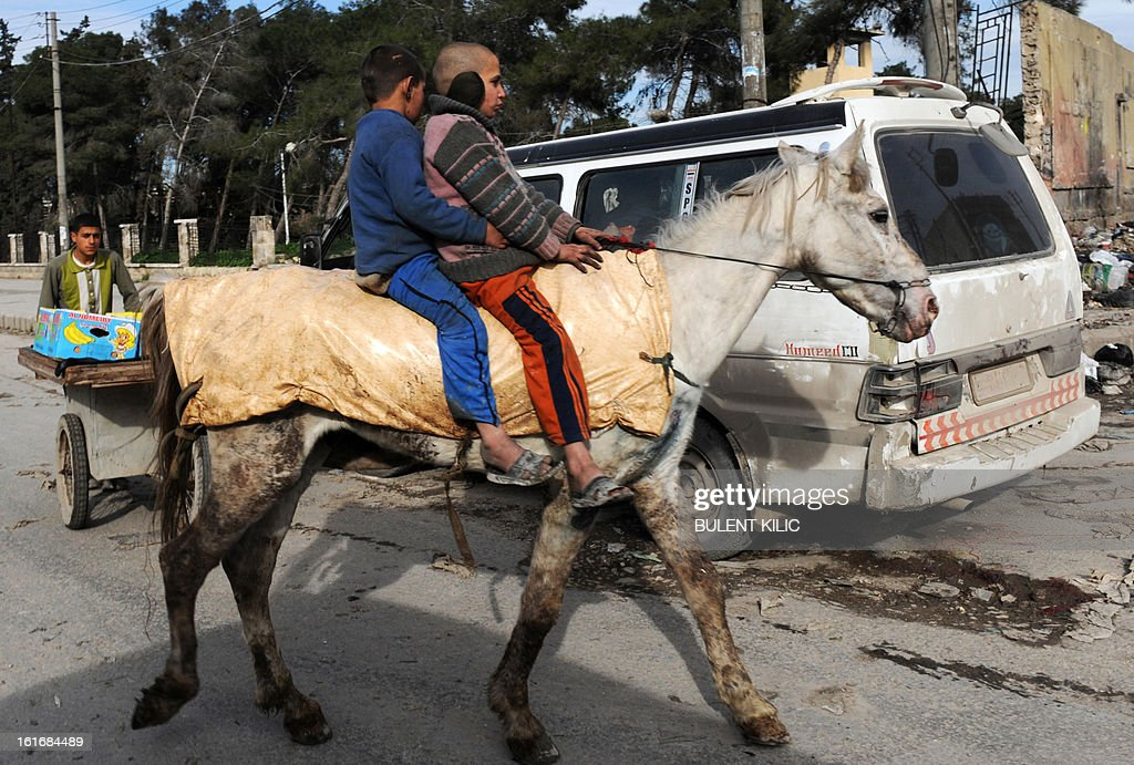 Syrian children ride a horse in the northern city of Aleppo on February 14, 2013. Syrian Foreign Minister Walid al-Muallem and opposition National Coalition chief Ahmed Moaz al-Khatib will make separate visits to Moscow for talks in the coming weeks, a top Russian diplomat said.