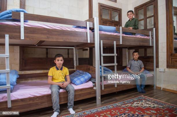 Syrian children sit on their beds at a boarding school which is a reconstructed mansion in Sanliurfa Turkey on April 6 2017 Fifty Syrian children who...